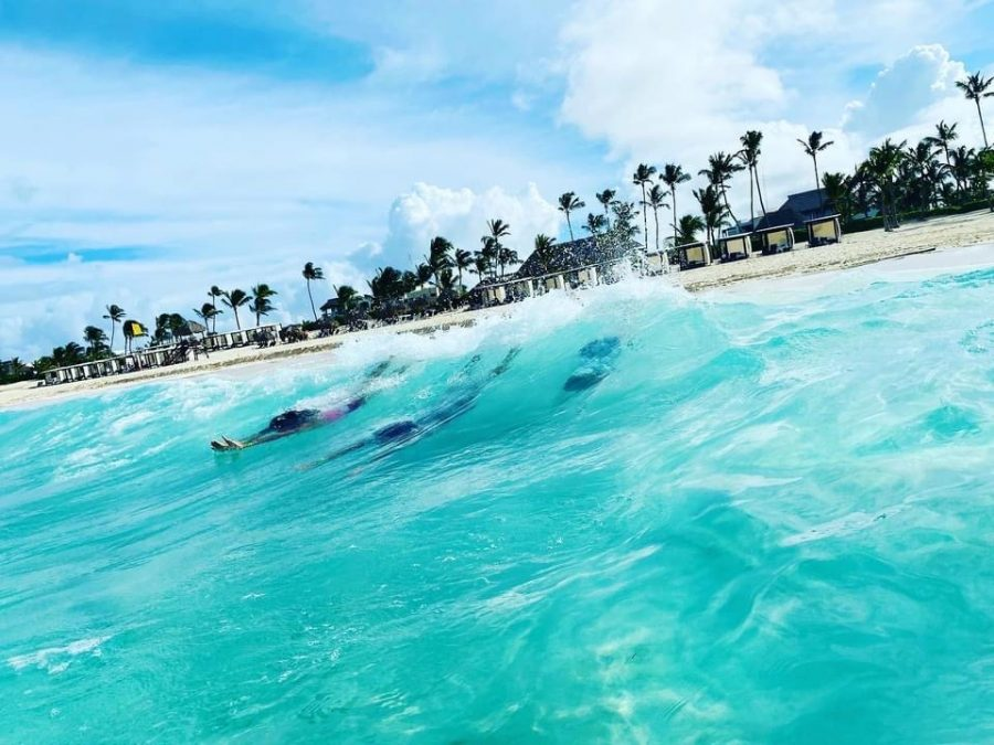 The beautiful waves on the shores of Punta Cana in the Dominican Republic. Three tourists from America take a break from online school to experience the jaw-dropping waves.