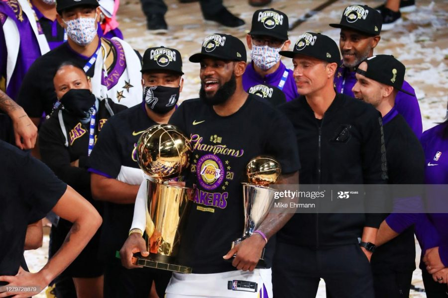 Lebron James celebrating with his team after winning the championship and his fourth NBA Finals MVP.