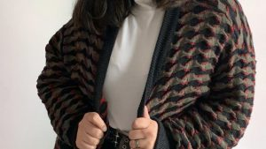 Owner of Vixxen Vintage, Yasmine Provincia, styles the vintage knitted cardigan that she had on sale.