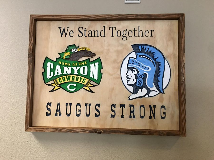 This memorable sign is currently hanging up in the Canyon High School office, and similar signs can be found in administrative offices across the district with their respective logos.