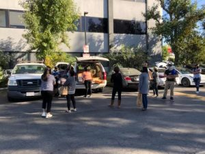 Families were seen gathering around 16933 Parthenia St. Northridge to show their support for the campaign and pick up their orders.