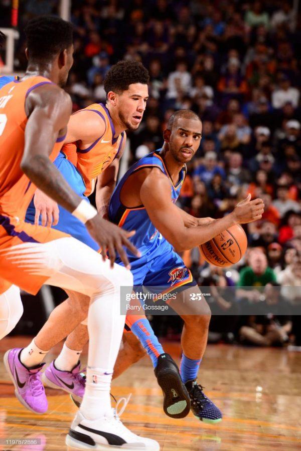 Chris Paul #3 of the Oklahoma City Thunder handles the ball against the Phoenix Suns
