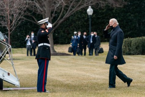 President Joe Biden salutes a U.S. Marine as he prepares to board Marine One on the South Lawn of the White House Friday, Jan. 29, 2021, before departing for Walter Reed National Military Medical Center in Bethesda, Maryland.