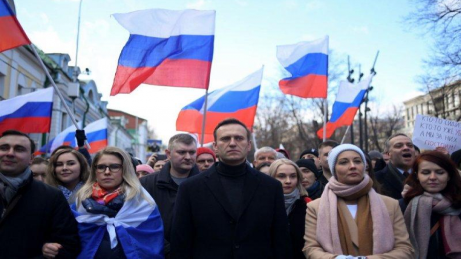 Russian opposition leader Alexei Navalny, his wife Yulia, opposition politician Lyubov Sobol and other demonstrators march in memory of murdered Kremlin critic Boris Nemtsov in downtown Moscow on February 29, 2020.