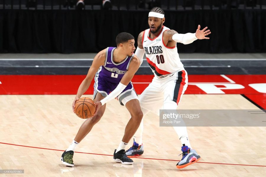 Tyrese Haliburton #0 of the Sacramento Kings works against Carmelo Anthony #00