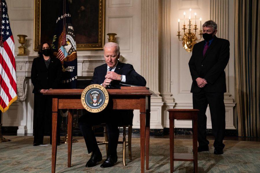 President Joe Biden signing documents regarding the climate change crisis.