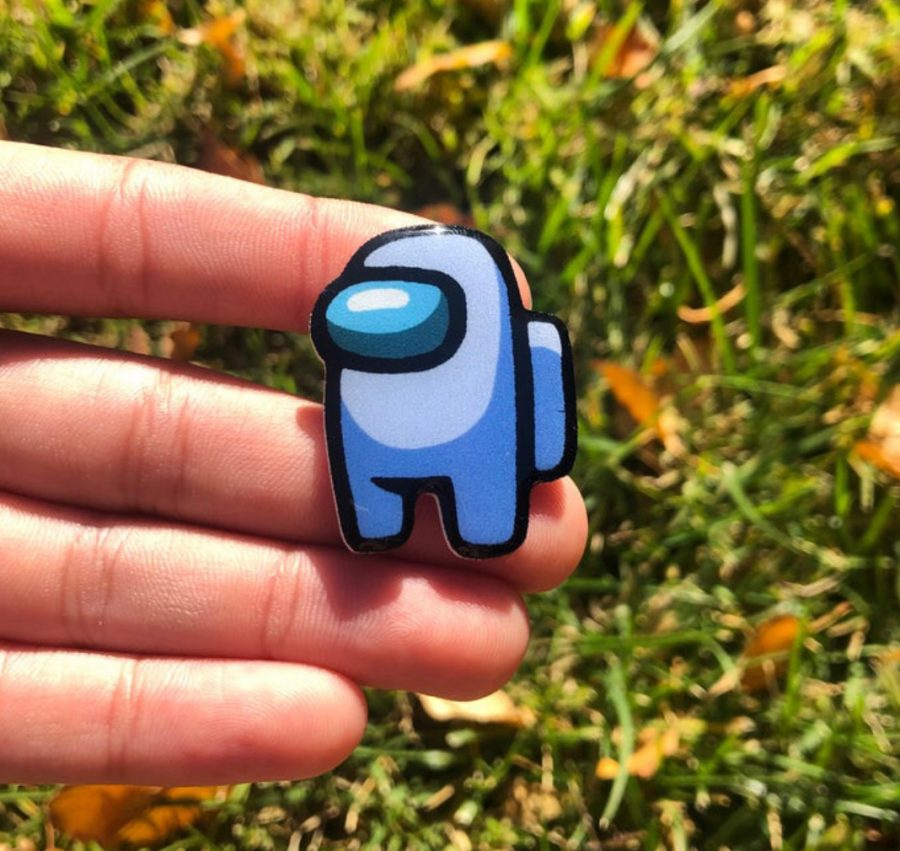 This Among Us pin and many others are available for $5 on Wilburst Pin's Etsy!
