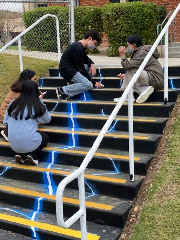 Joseph Mercado, Joanna Castro, Leslie Sanchez, and Broch Gillies are in the middle of completing their designs on one of the stair cases.
