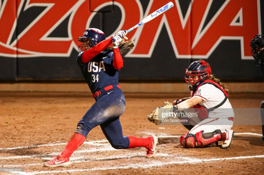 United States catcher Dejah Mulipola (34) swings a pitch during an exhibition softball game between the United States and the Arizona Wildcats.