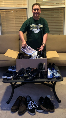 Freshman, Anthony Santos, collecting shoes for Soles4Souls.