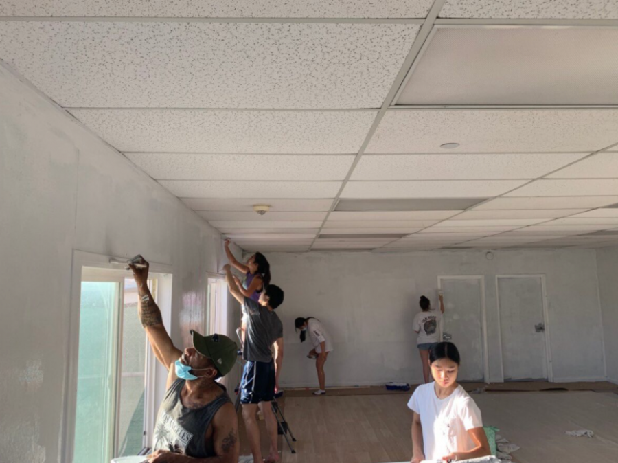 Global Prep Academy student volunteers repaint the Bridge to Home shelter.