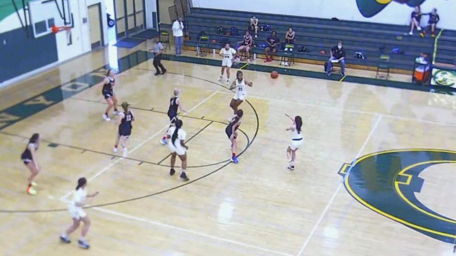 Sophomore, Aaliyah Garcia passing the ball to freshman, Koko Booker.