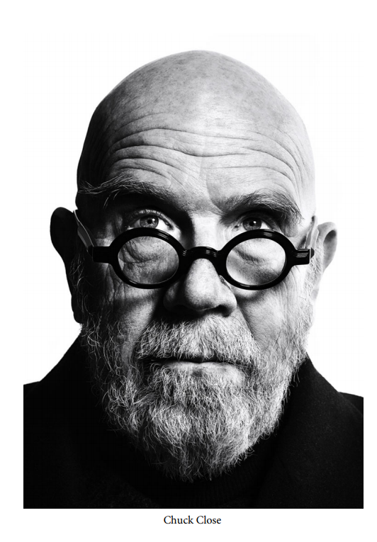 The inspiration image of Chuck Close that Kevin Torres is drawing.
