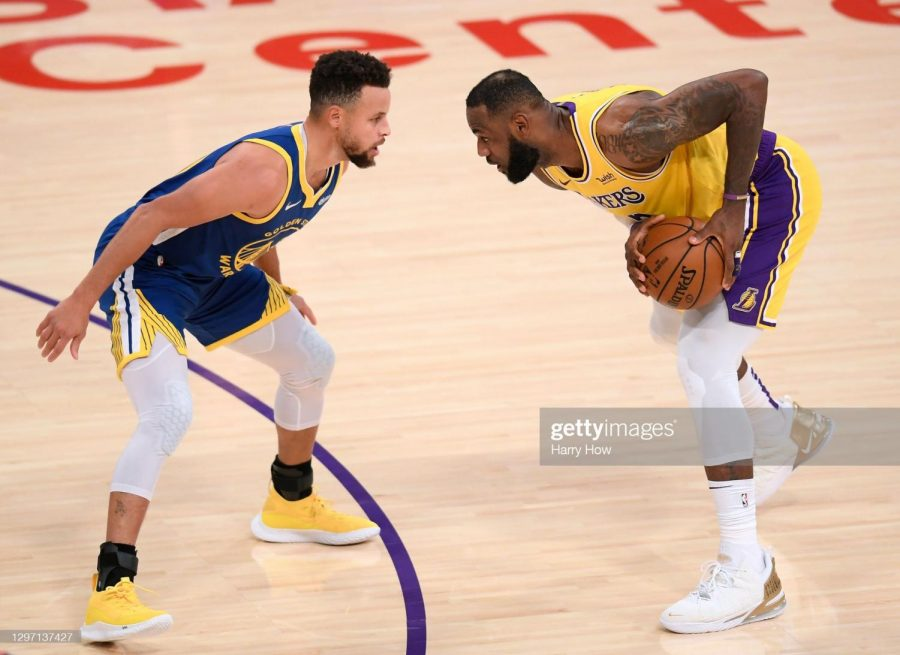 LeBron James #23 of the Los Angeles Lakers is guarded by Stephen Curry #30 of the Golden State Warriors.