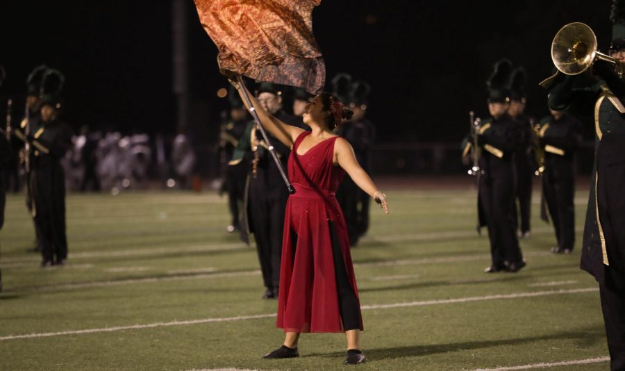 Brenda, color guard team captain, performing the first movement of the Brigades routine.
