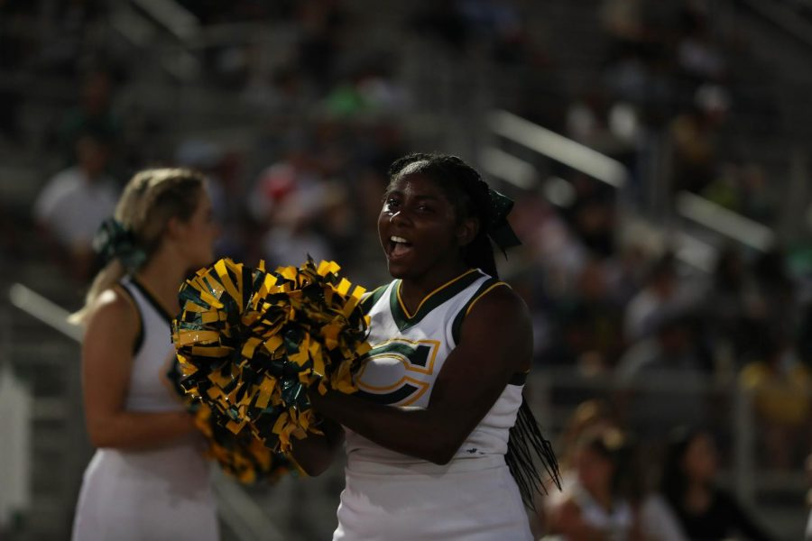 Varsity cheerleader Ebony Lubin cheering on the Cowboys.