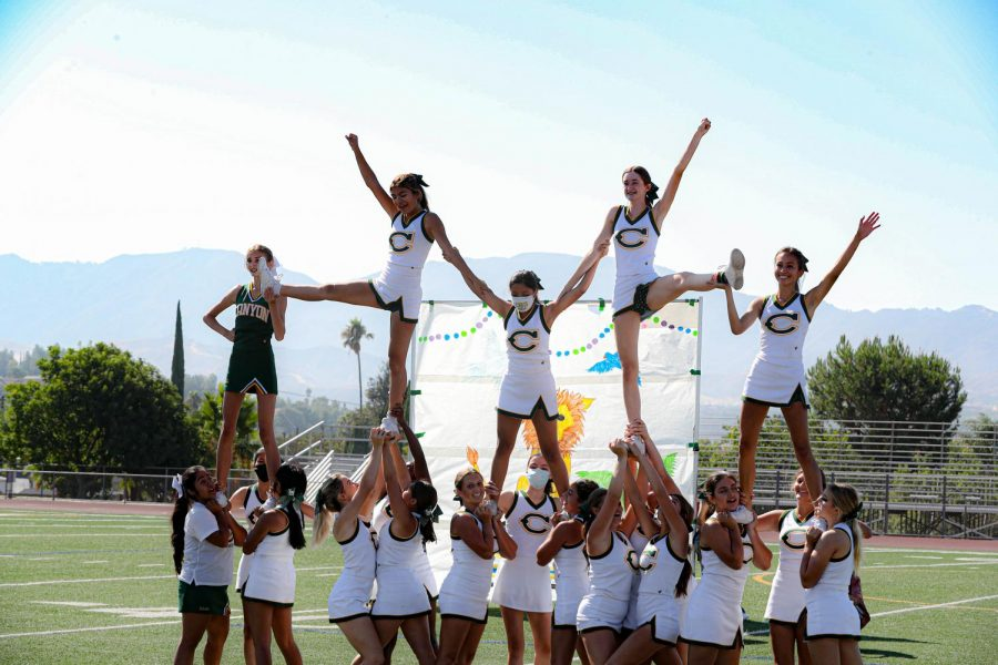Varsity Cheer, featuring a couple JV cheer girls, in the final pyramid stunt at the rally.