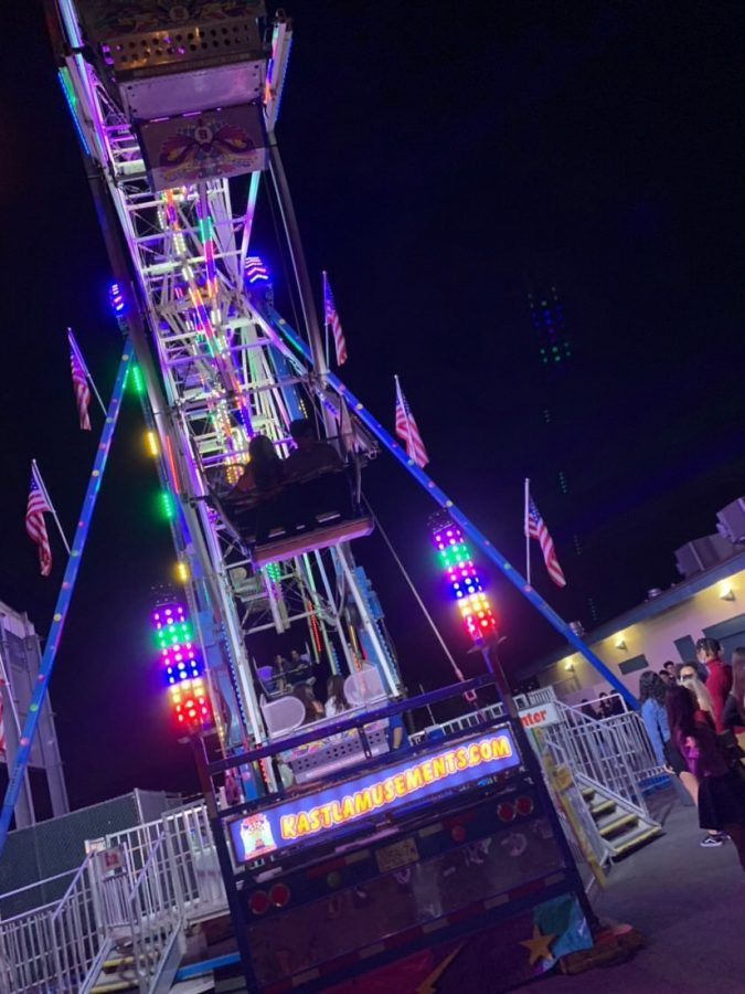 Students wait for a chance to get on the extremely popular Ferris Wheel ride.