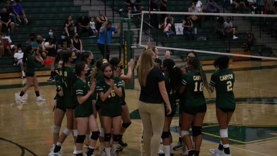 Canyon Girls Volleyball getting ready to play after having a team huddle and discussing different strategies for the game!